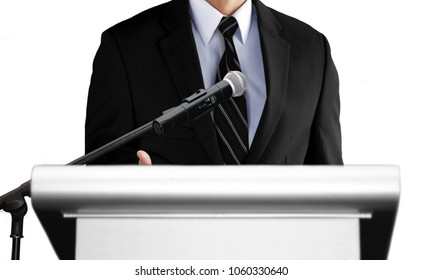 man giving speech using microphone on stage