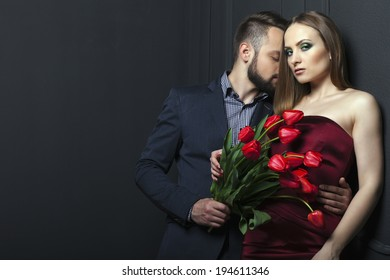 man giving a woman a bouquet of tulips