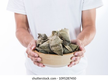 A man is giving zongzi(rice dumpling) to others as a present  on Dragon Boat Festival, Asian traditional food, white background