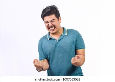 Man glad screaming casual man celebrating victory.