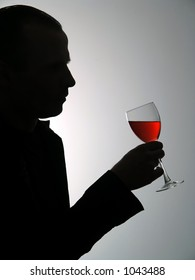 Man with glass with red wine