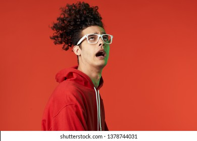 man in glasses with curls emotions