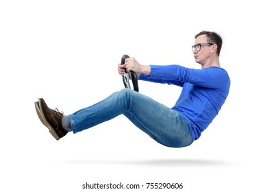 Man in glasses drives a car with a steering wheel, isolated on white background