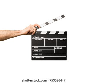 Man with glasses holding a clapperboard