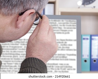 Man with glasses looking at screen
