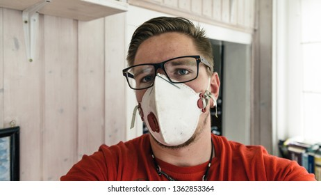 Man with glasses and a respirator or mask