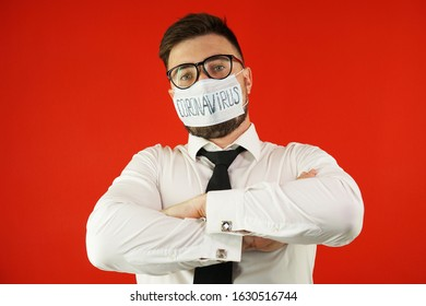 A man with glasses, a shirt and a mask with the inscription coronavirus. Coronavirus concept. Coronavirus epidemic.