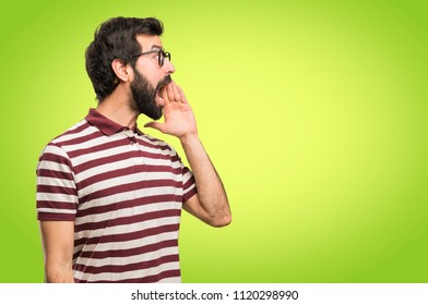 Man with glasses shouting on colorful background
