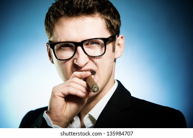 Man in glasses smoking cigar