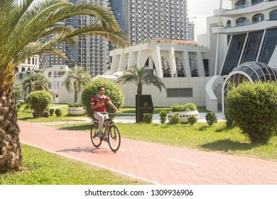 A man goes for a drive on a bicycle in city Batumi.2018 year.