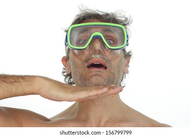 man with goggles makes a running out of oxygen gesture