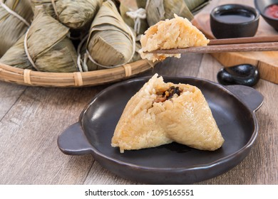 A man is going to eat zongzi or rice dumpling on Dragon Boat Festival, Asian traditional food