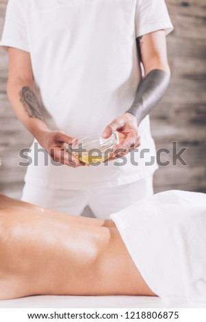 man massaging womans body