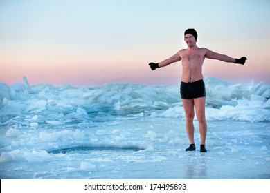 Man is going to swimm in an ice-hole