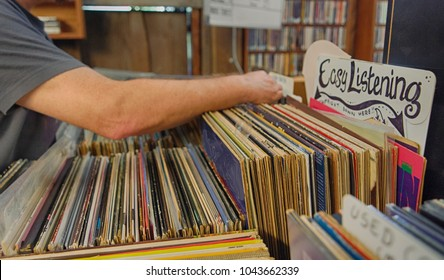 Man going through used records at a record store