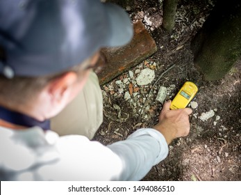 Man with with going wild geiger counter in Pripyat, Chernobyl Exclusion Zone, Ukraine