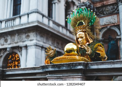 A man with a golden ball at the Venice Carnival 2018.