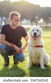 Man with golden retriever in the park