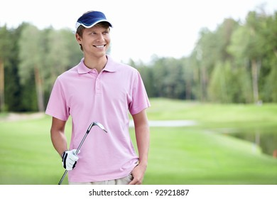 Man with golf club outdoors