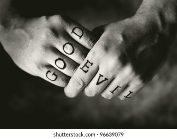 """Man with """"Good"""" and """"Evil"""" (fake) tattoos on his fingers."""