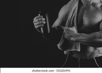 A man with a gorgeous muscular body on a black background