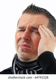 Man grasping his head where the pain is