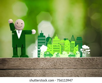Man in a green cloth and green environment city, ecology concept