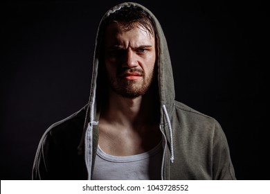 man in green sportswear looking with contempt and dissatisfaction. angry look. bad mood. evil man. full of negativety
