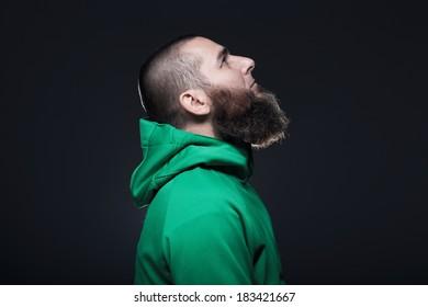 Man in green sweatshirt, looking up
