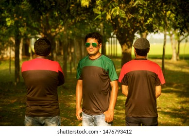 Man in a green t shirts standing around a place