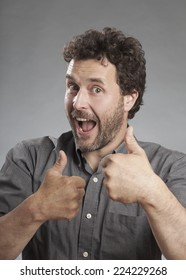 Man in grey shirt showing thumbs up