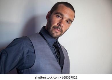 man in a grey suit portrait