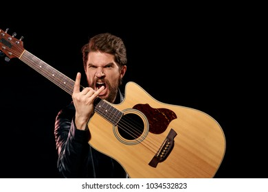 man with guitar, rock, black background