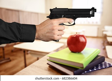 Man with gun in classroom. School shooting concept