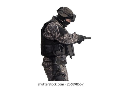 Man with a gun at firing range