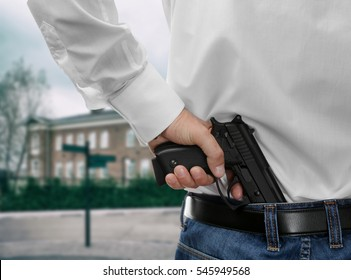 Man with gun on school background