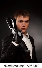 Man with gun over gradient gray