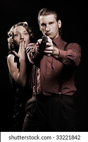 man with gun protecting his woman. retro portrait