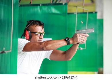 Man with gun at shooting range