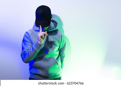 the man, guy in the blank black , baseball cap, grey hoody,  on a white background
