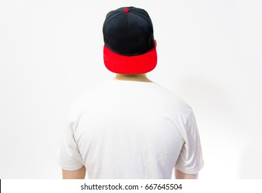 the man, guy in the blank black, red baseball cap, on a white background with white t shirt, mock up, free space, logo presentation, back