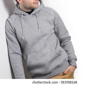 man, guy in Blank grey hoodie, mock up isolated. Plain hoody design presentation.