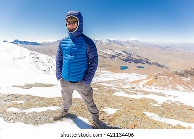 Man guy tourist standing mountain snow summit cold weather, beautiful landscape Cordillera Real range, Bolivia tourism destination.