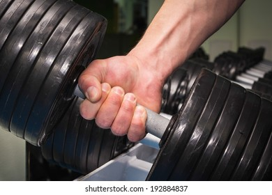 man in the gym doing exercises