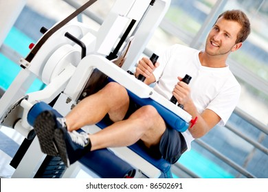 Man at the gym exercising on a machine