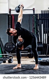 Man in the gym with kettlebells and weights.