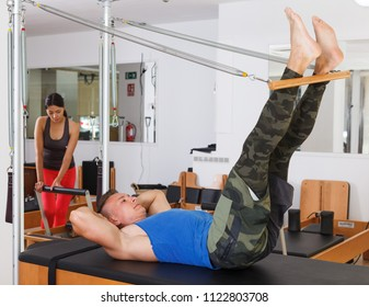 man in the gym with modern exercise machines