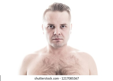 Man with hairy chest look into the camera