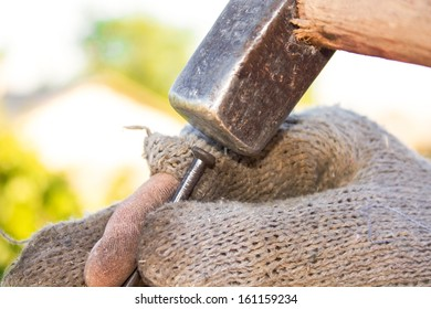 Man with a hammer and nails