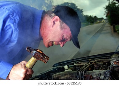 man with a hammer trying to smash his broken down car at night
